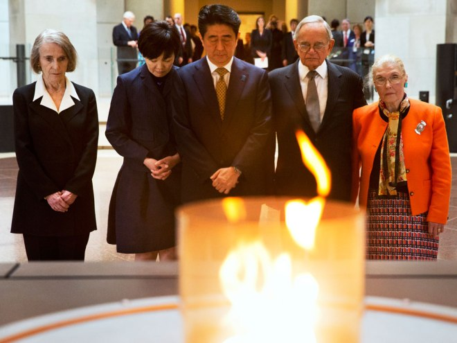 Abe and wife Akie at the U.S. Holocaust Memorial Museum with Holocaust survivors