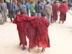 Young Buddhist monks-in-training having a little fun at Boudhanath