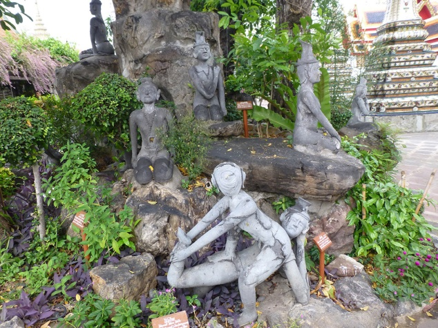 A statue garden in Wat Pho showed the various positions of Thai-style yoga. Each pose targets a specific ailment.