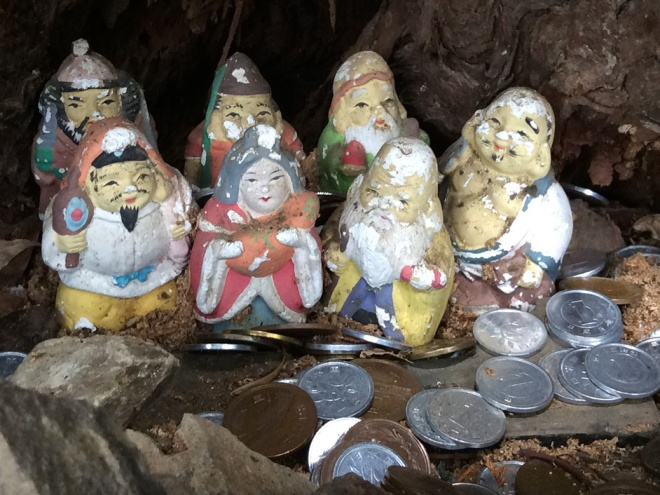 Several small shrines appear along the path, like this one of the Seven Gods of Fortune (七福神). Hikers leave coins at each shrine for good fortune.