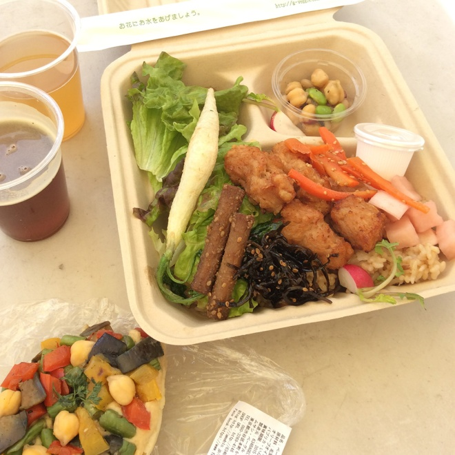 "Lunch at the UN Farmers Market—a vegetarian take on Hawaiian plate lunch, a hummus and veggie bagel pizza and Burnside Brewing's ""Too Sticky To Roll India Red Ale"" and ""Sweet Heat,"" an apricot and Scotch bonnet pepper wheat beer."
