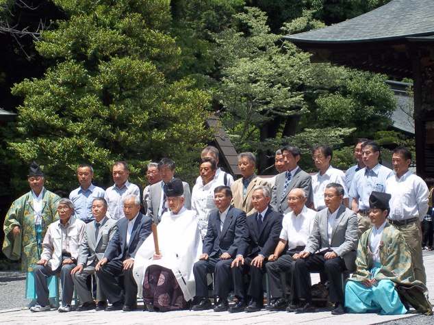 A ceremony took place in the shrine while we were there and they gathered for a photo after. The Shinto priest (kannushi) is seated in the middle. It appeared to be a business group, perhaps receiving a blessing for an upcoming project, a common occurrence in Japan.