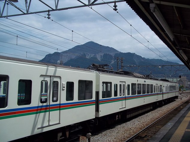 The train to the poppy fields with Mt. Buko in the background