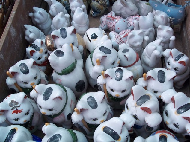 A box full of cats—maneki neko (beckoning cat) to be specific.
