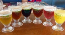 The six-glass sampler at Izu Kogen Brewery included a yamamomo champagne beer, an orange beer and a stout made in honor of the 1998 summit between Russian president Boris Yeltsen and Japan's prime minister Ryutaro Hashimoto