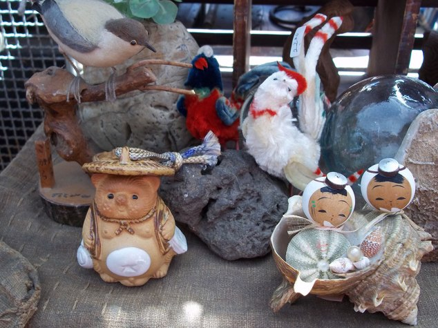 Miscellaneous handmade dolls and figurines. The guy with the white belly on the left is a Tanuki, often found in shops and restaurants as a very-thorough lucky charm.