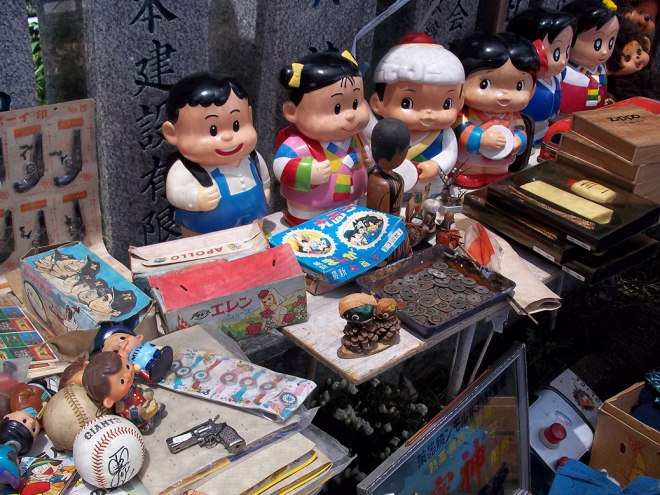 A mismatch of Japanese toys, dolls and autographed baseballs.