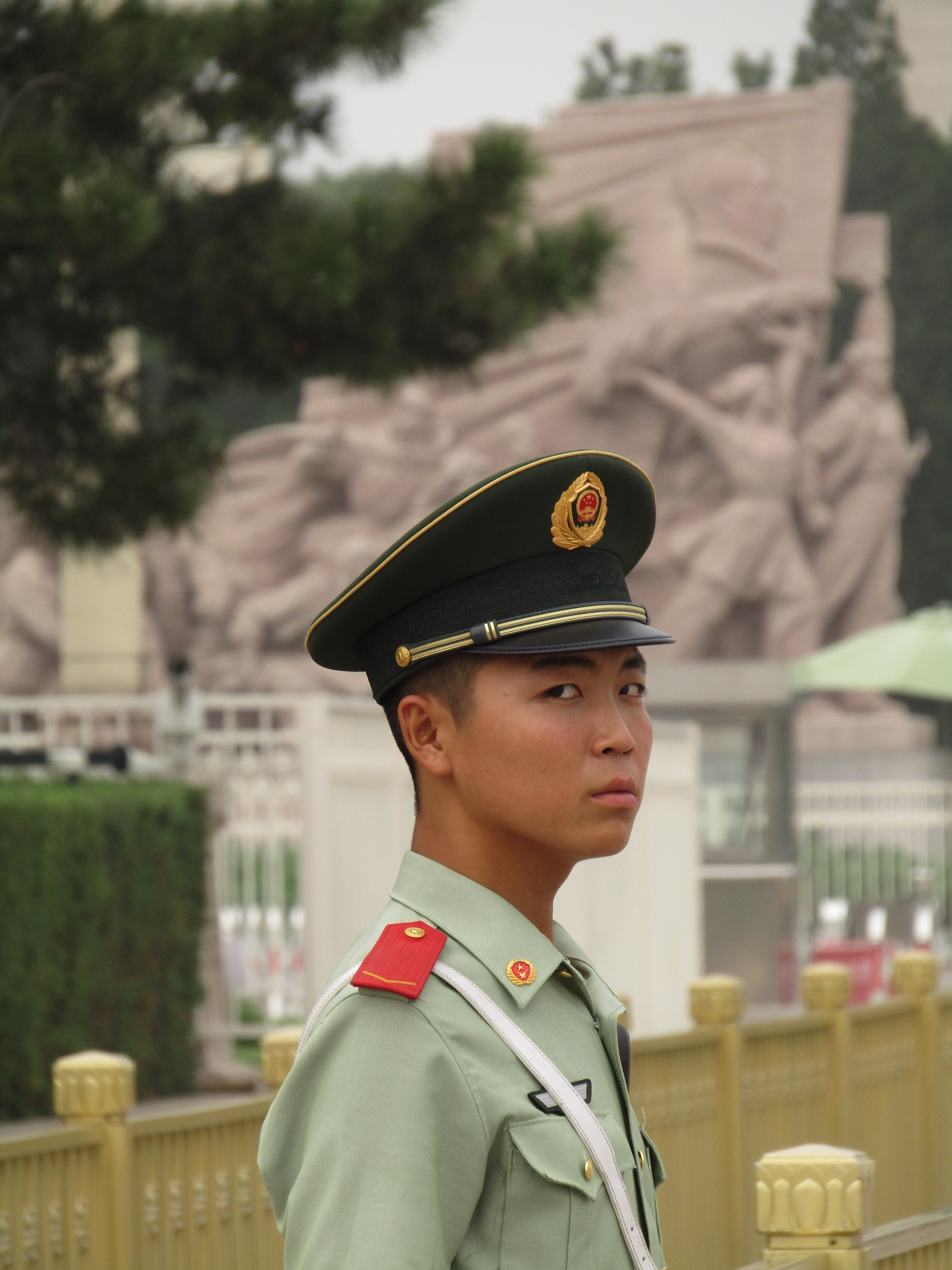 A young guard in Tiananmen Square gives us the side eye