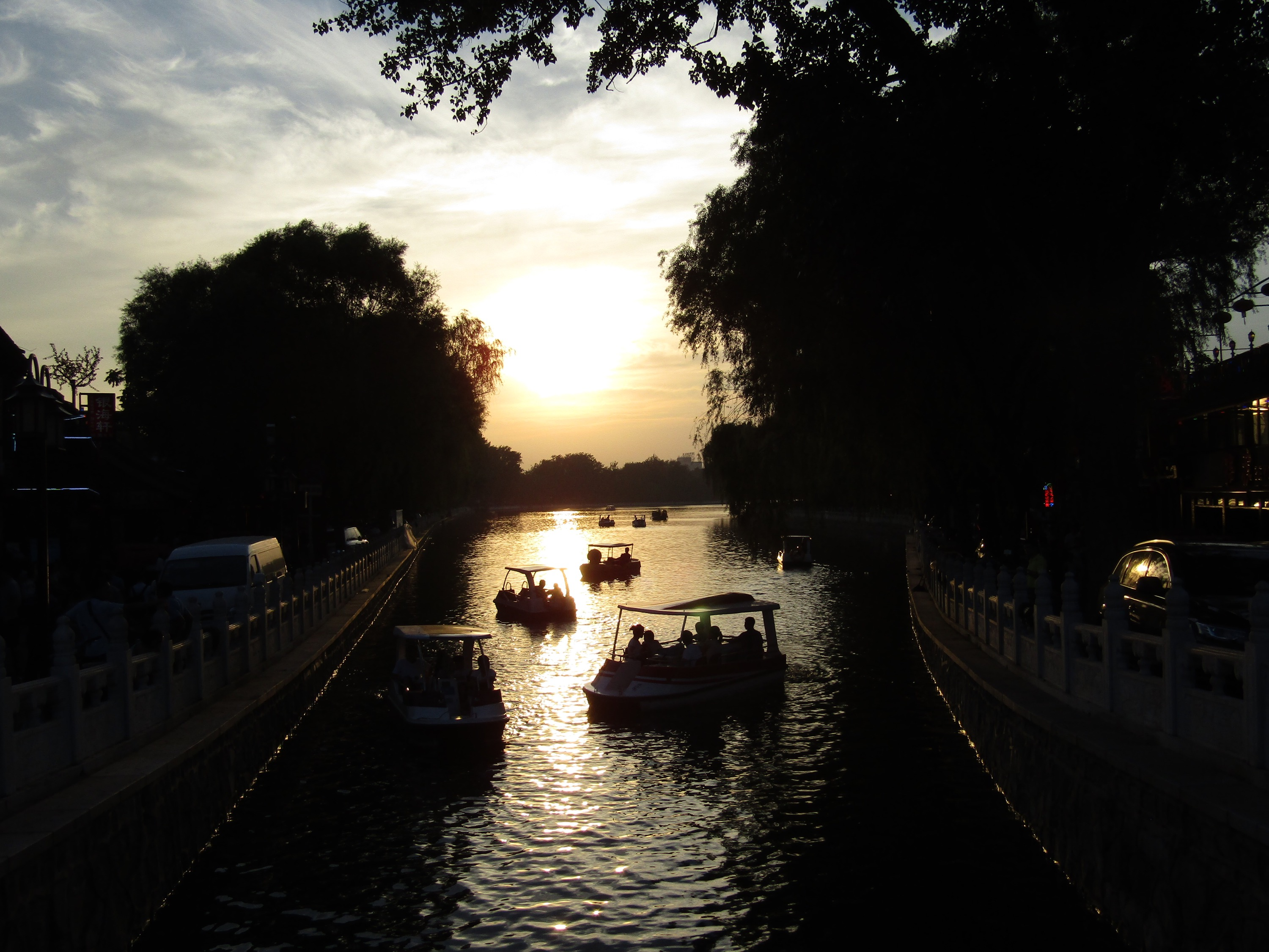 Sunset over Hoihai Park, a lively riverwalk area surrounded by bars and restaurants featuring live music.