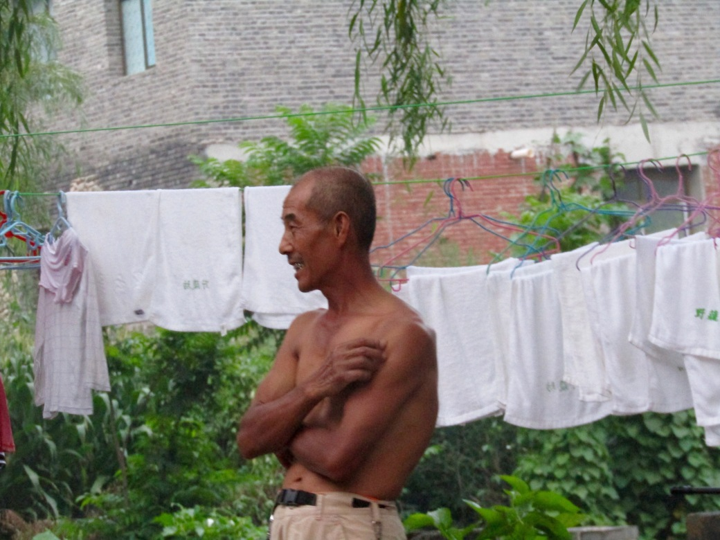 A local man at Gubeikou Village, our guesthouse near the Great Wall, enjoying watching his neighbors playing badminton.