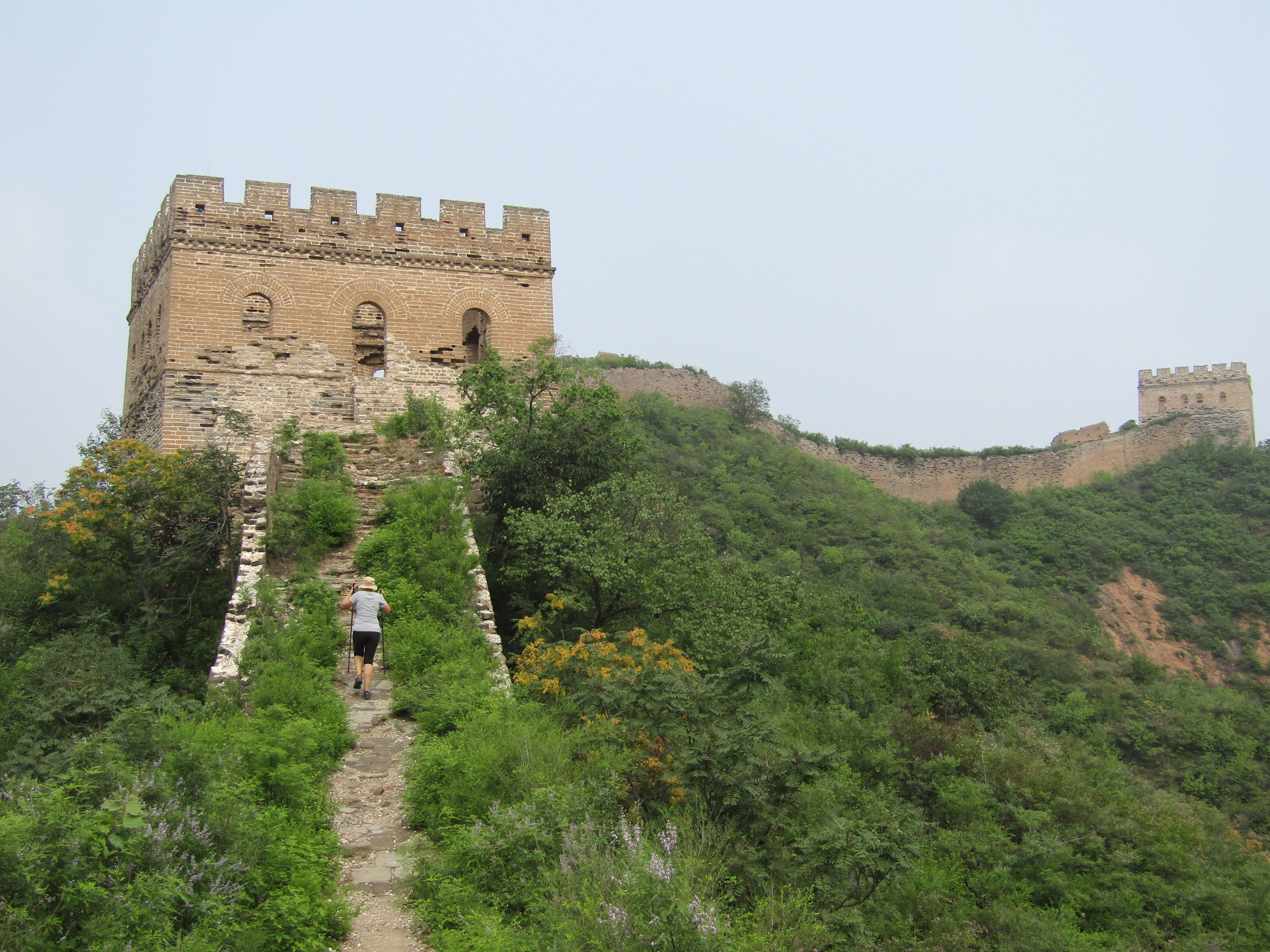 Hiking up some of the steep steps between the different guard towers. It's easy to imagine soldiers protecting China from invaders with the intact fireplaces and lookouts.