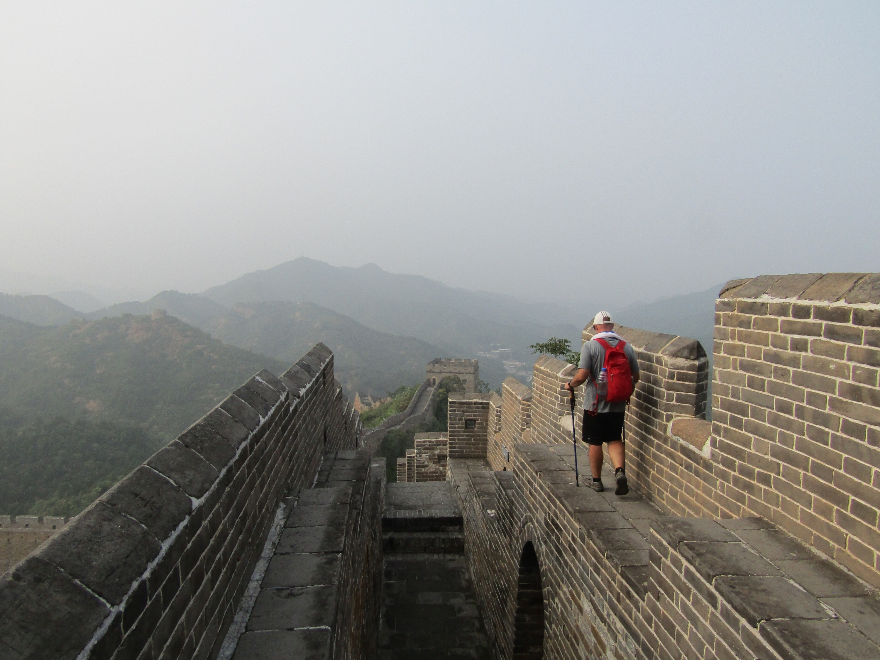 Some parts of the wall have narrow elevated walkways, but with enough room to safely cross.