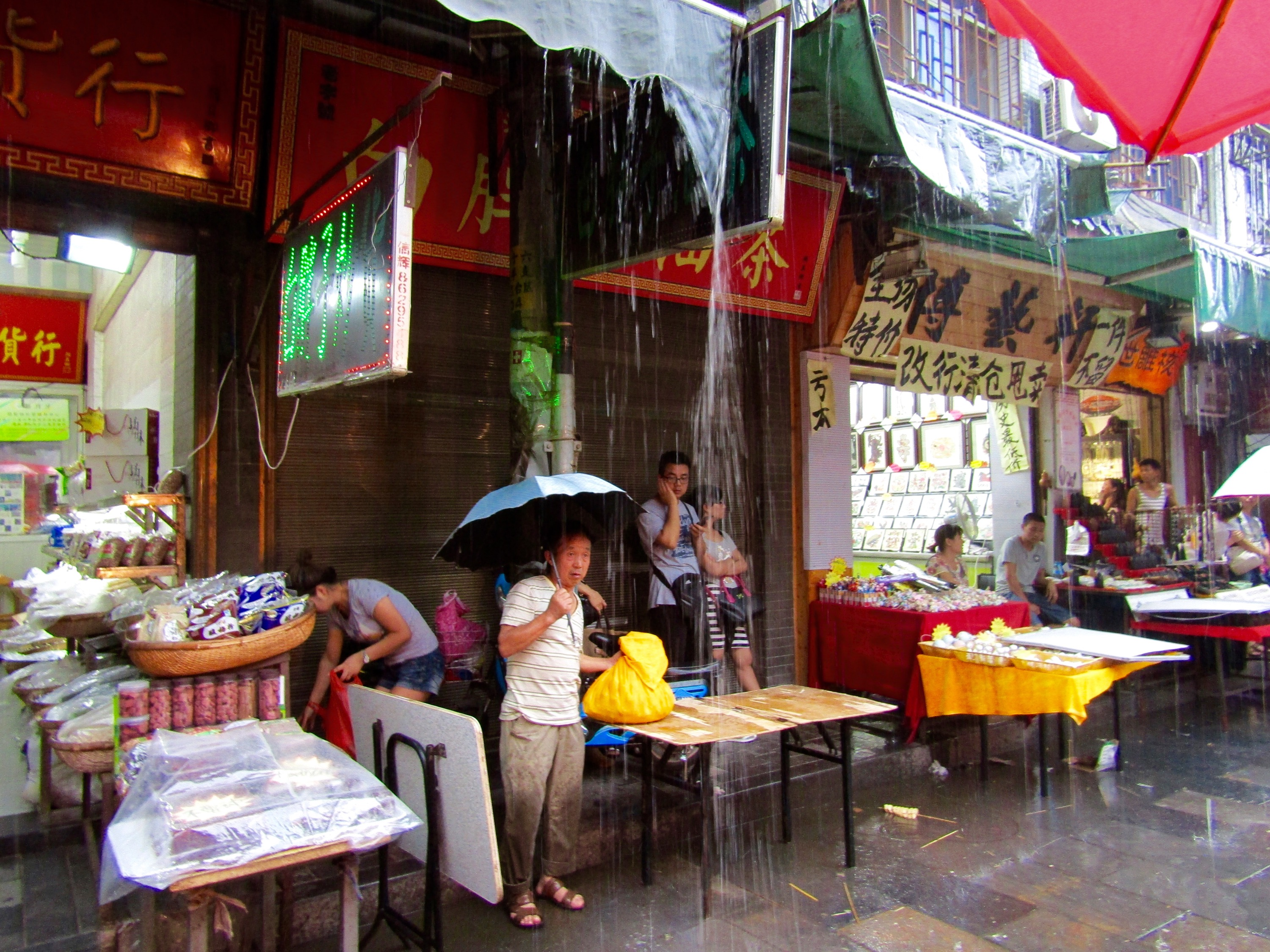 Our time in the Muslim Quarter was cut short by a freak rainstorm that sent everyone scurrying for cover. on our rain-soaked walk back to the hotel, we picked up dinner from various local food stalls... a great way to get to know the local culture.