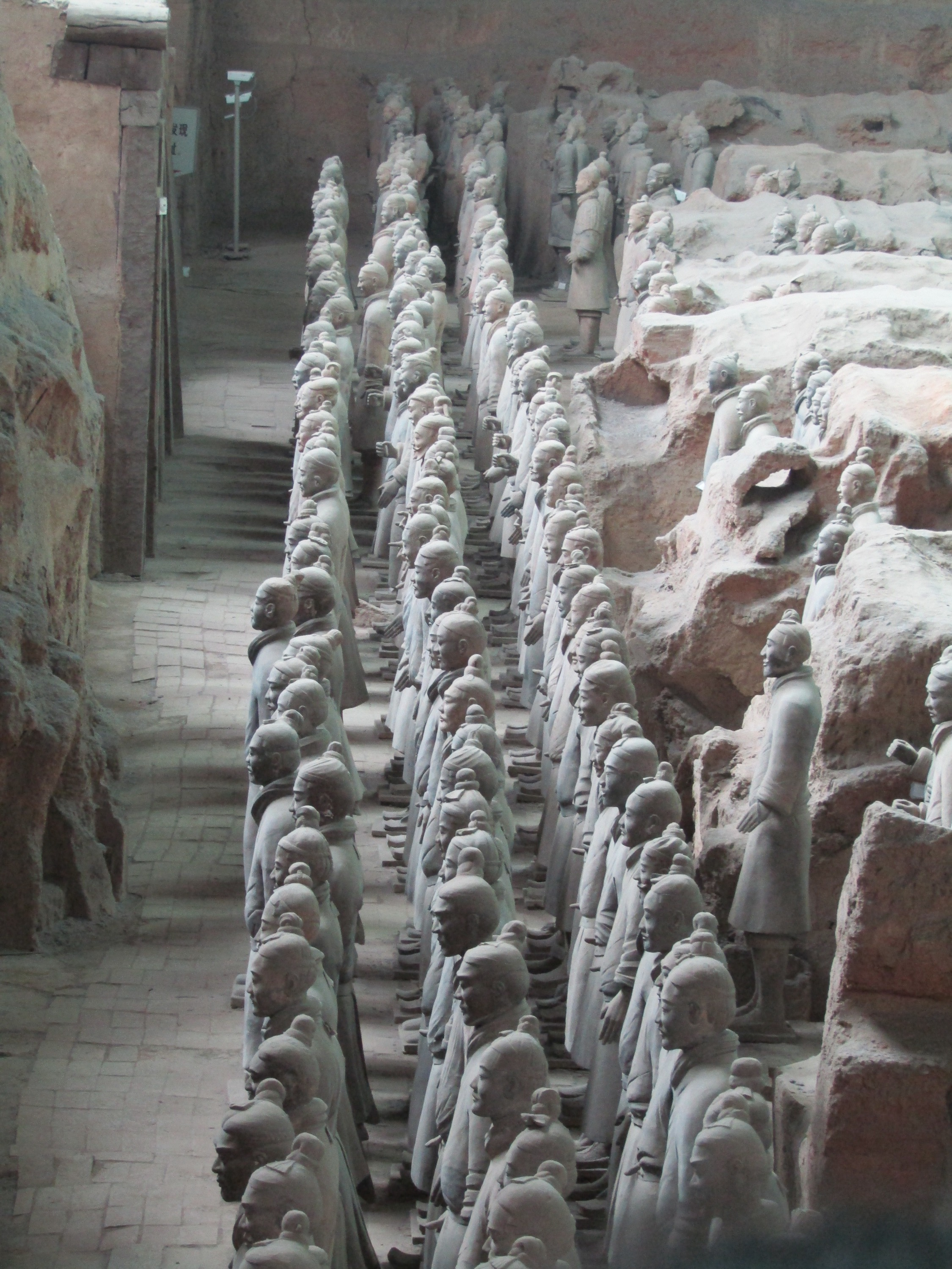 Qin's tomb was discovered two kilometers to the west of the army in a man made mound of earth the size of a small town. It's surrounded by rivers of mercury and the gas is so toxic that it has not yet been exhumed. His army faces east to draw life from the rising sun.