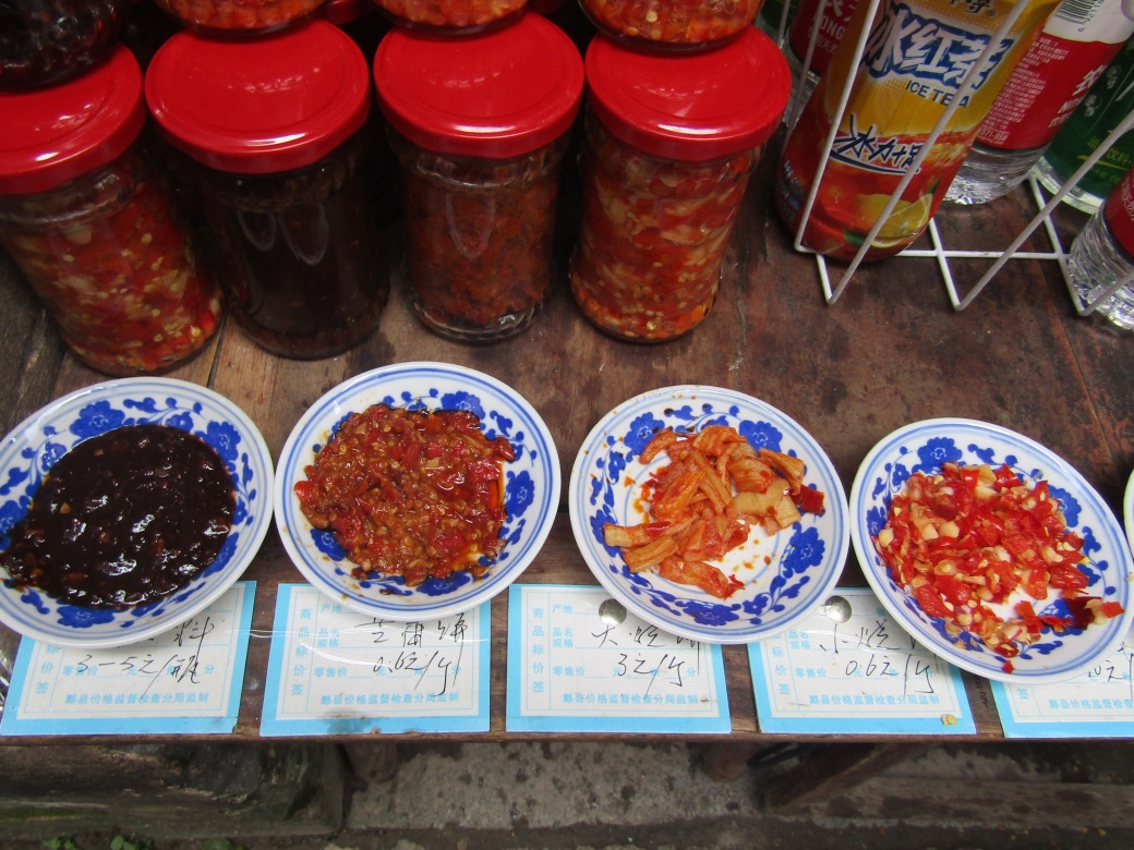 Founded by the family of a Han Dynasty general, the village thrived thanks to the merchant trade. That trade continues today as villagers create art and food for the throngs of tourists who visit each day. This shop topped its simple fried tofu with different blends of spicy pepper relish—equal parts fiery and delicious.
