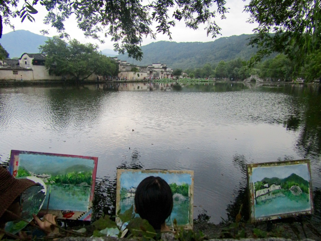 The angles, lighting and colors of the ancient village were a major draw for artists, many of whom lined the banks of South Lake to capture the reflection of Picturesque Bridge in the still waters.