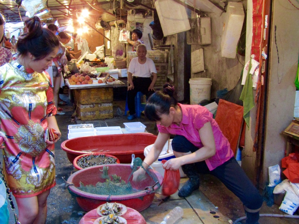 The market was the real-deal, selling live eels, frogs and turtles. Upon completion of the customer's order, this vendor killed and cleaned the bullfrogs right in the street.