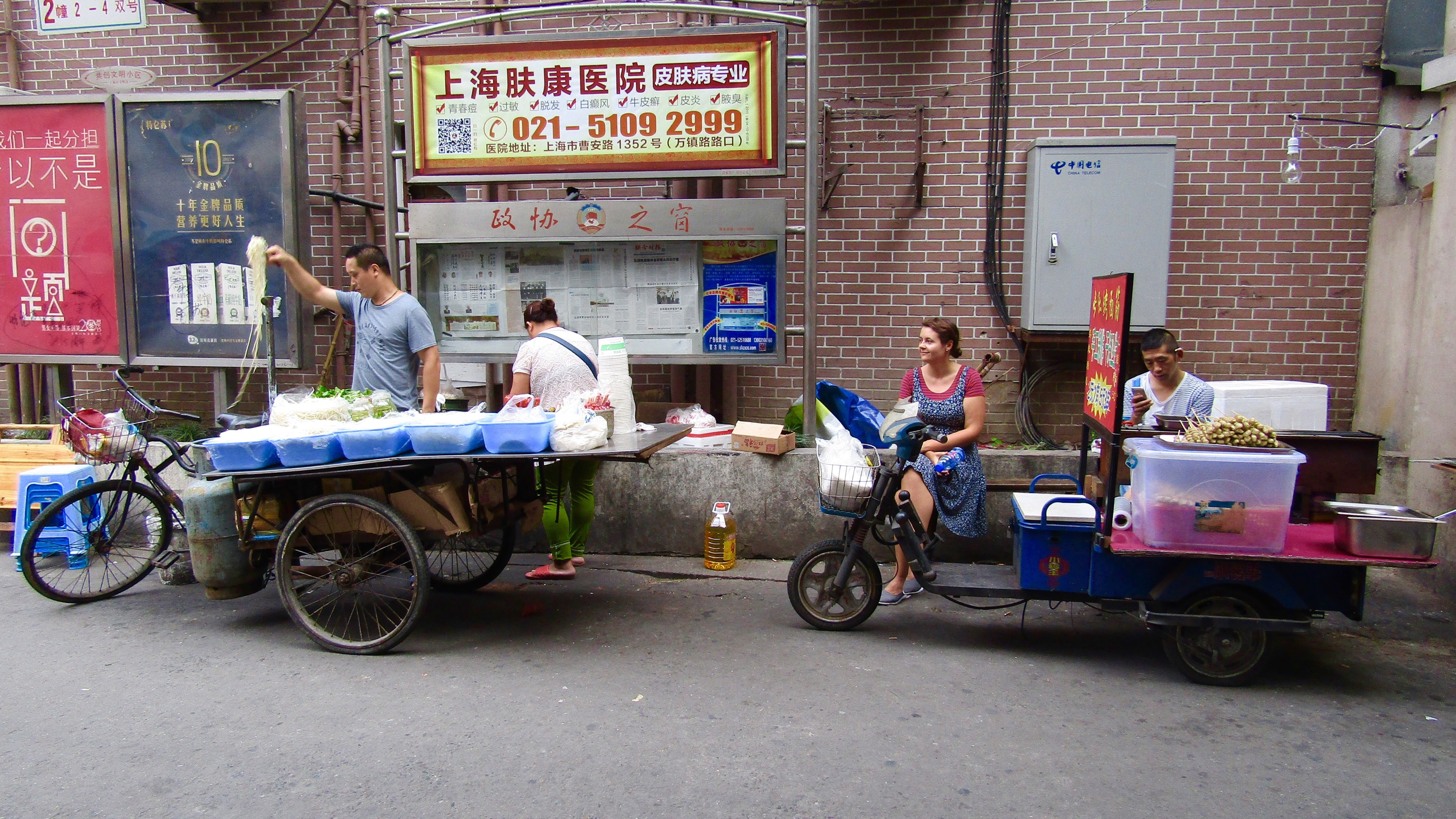 Every afternoon, this man set up his noodle stand (a bicycle with a flatbed and propane gas tank attached) around the corner from our hostel in Shanghai. He'd make stir-fried noodles and rice until late in the evening. We stopped in twice during our stay, getting a filling meal for about $1.50 USD each.