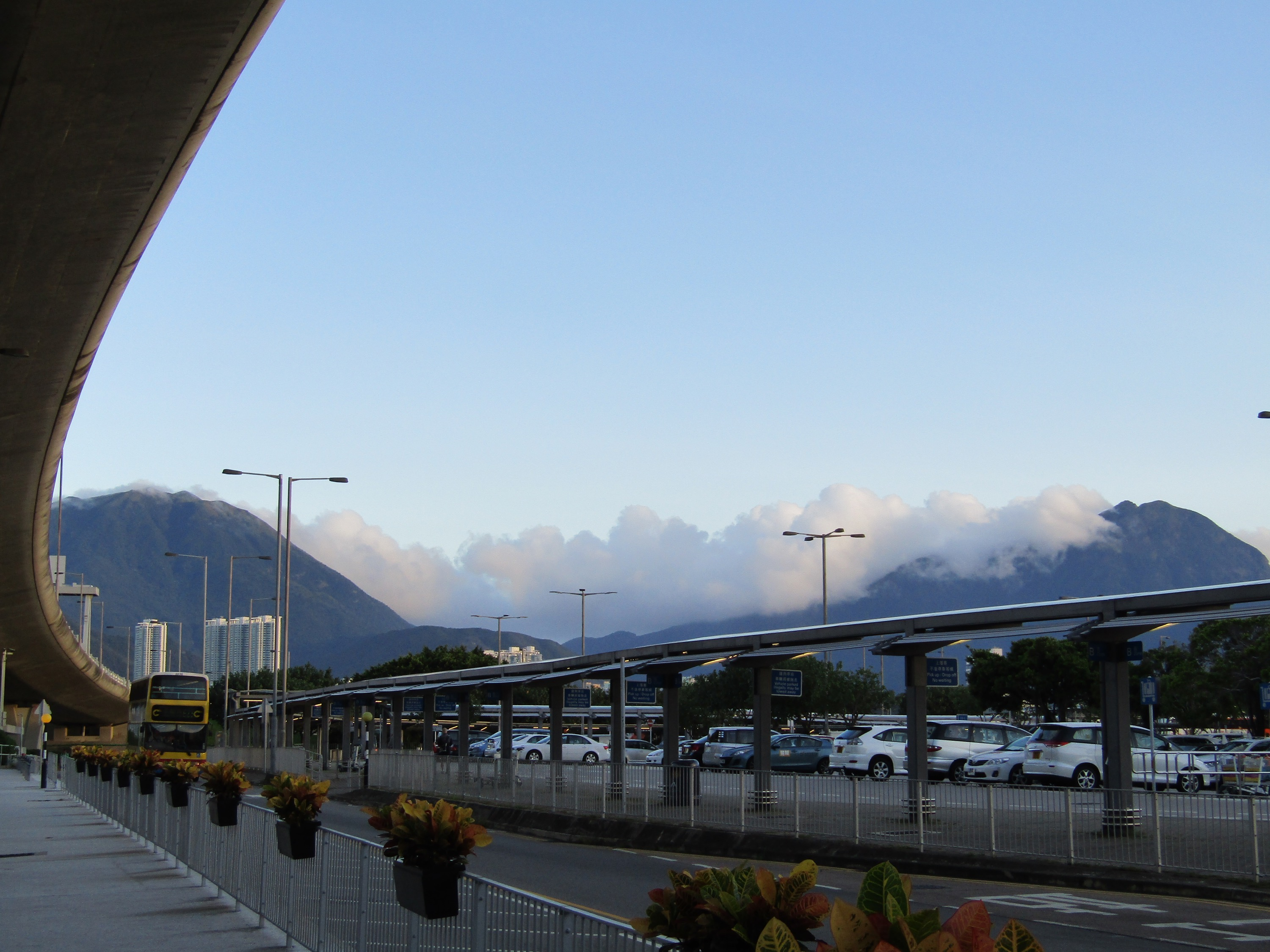 The view of the clouds rolling in over the mountains at Hong Kong International Airport made up for the fiasco of catching a bus to the city (honestly, who has exact change when they leave the airport?).