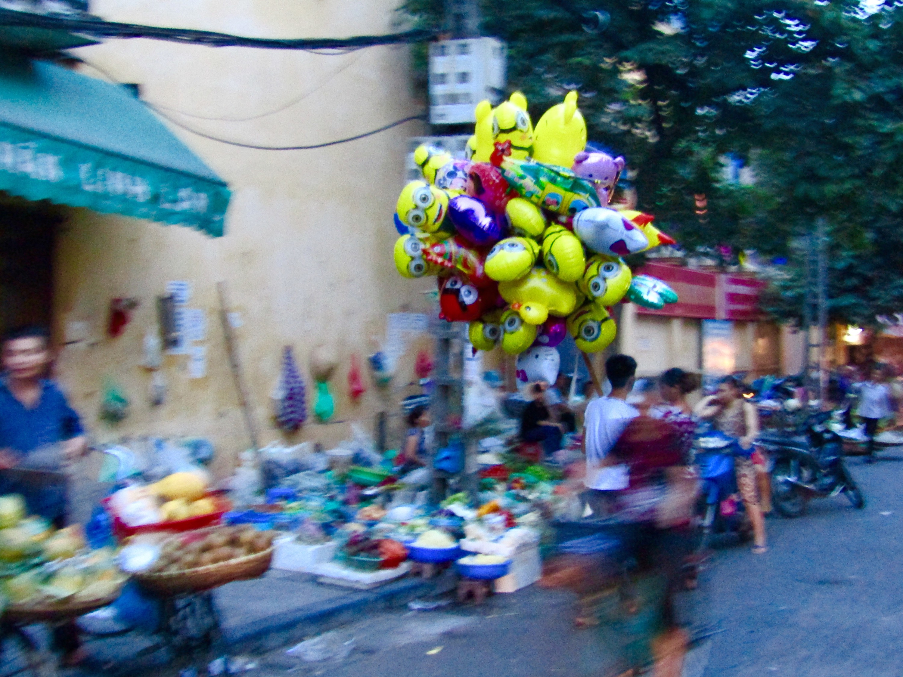 We followed this balloon vendor for a few blocks as he tried to unload one of his many Minions.