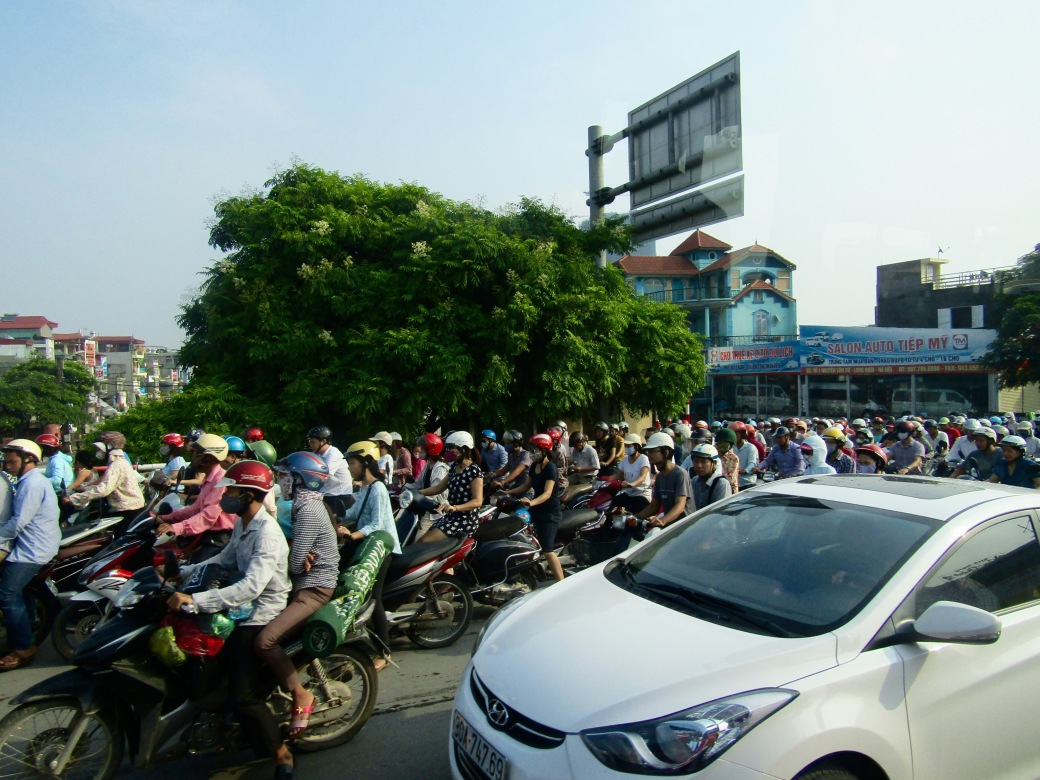 We left for Halong Bay during Hanoi's morning rush hour. High taxes on automobiles make scooters and motorbikes the preferred mode of transportation among the nearly 3 million Hanoians.