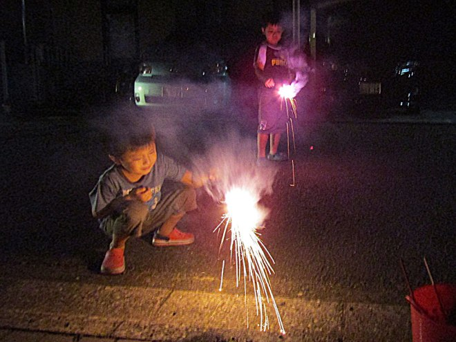 Two of the kids light up another round of sparklers