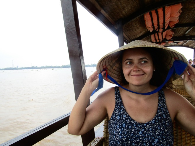 The traditional conical hats are available for sale all over Vietnam. On a particular sunny day, it seemed like a good investment. It would also be donned by our guide in a demonstration of the carrying pole during the tour.