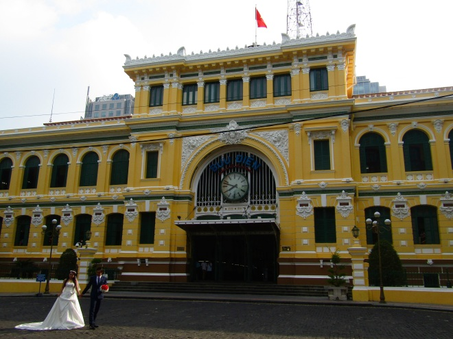 One of many couples taking wedding photos in front of the iconic Saigon Central Post Office. It was built by the French in the late 1800s and is still an active post office in addition to being a popular tourist site. Architect Gustave Eiffel, famous for Paris tower that bears his name, was among those who designed the building.