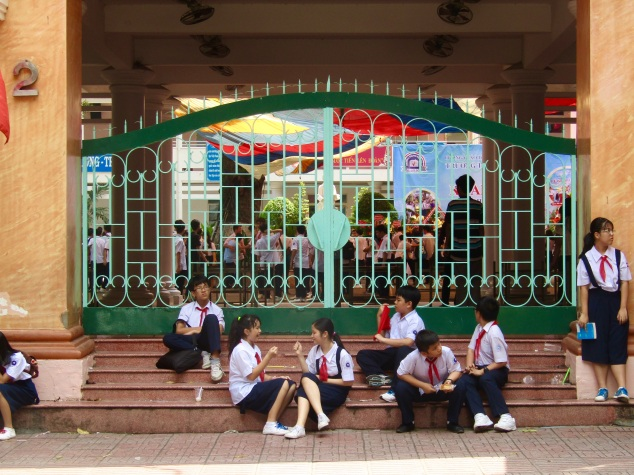 Students in HCMC outside their school on a Saturday. The school week is six days long, but there was extra activity as they celebrated the beginning of a new school year with loud music, loud speeches and general loudness.