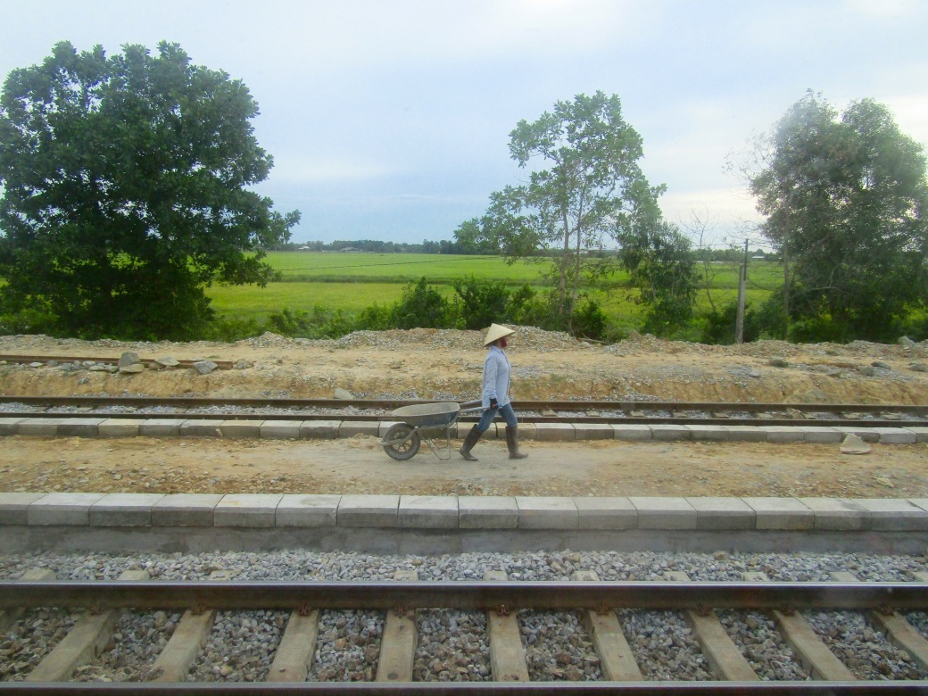 Our guide woke us up early on the overnight train from Hanoi to Hue as we approached the Ben Hai River, better known as the demilitarized zone that separated North and South Vietnam. A group of women were already hard at work, repairing the area near the railroad tracks.