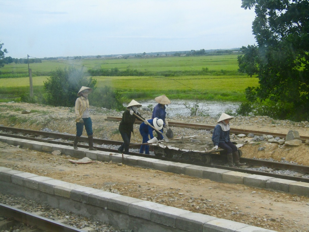 Women working on the train tracks near the Ben Hai River.