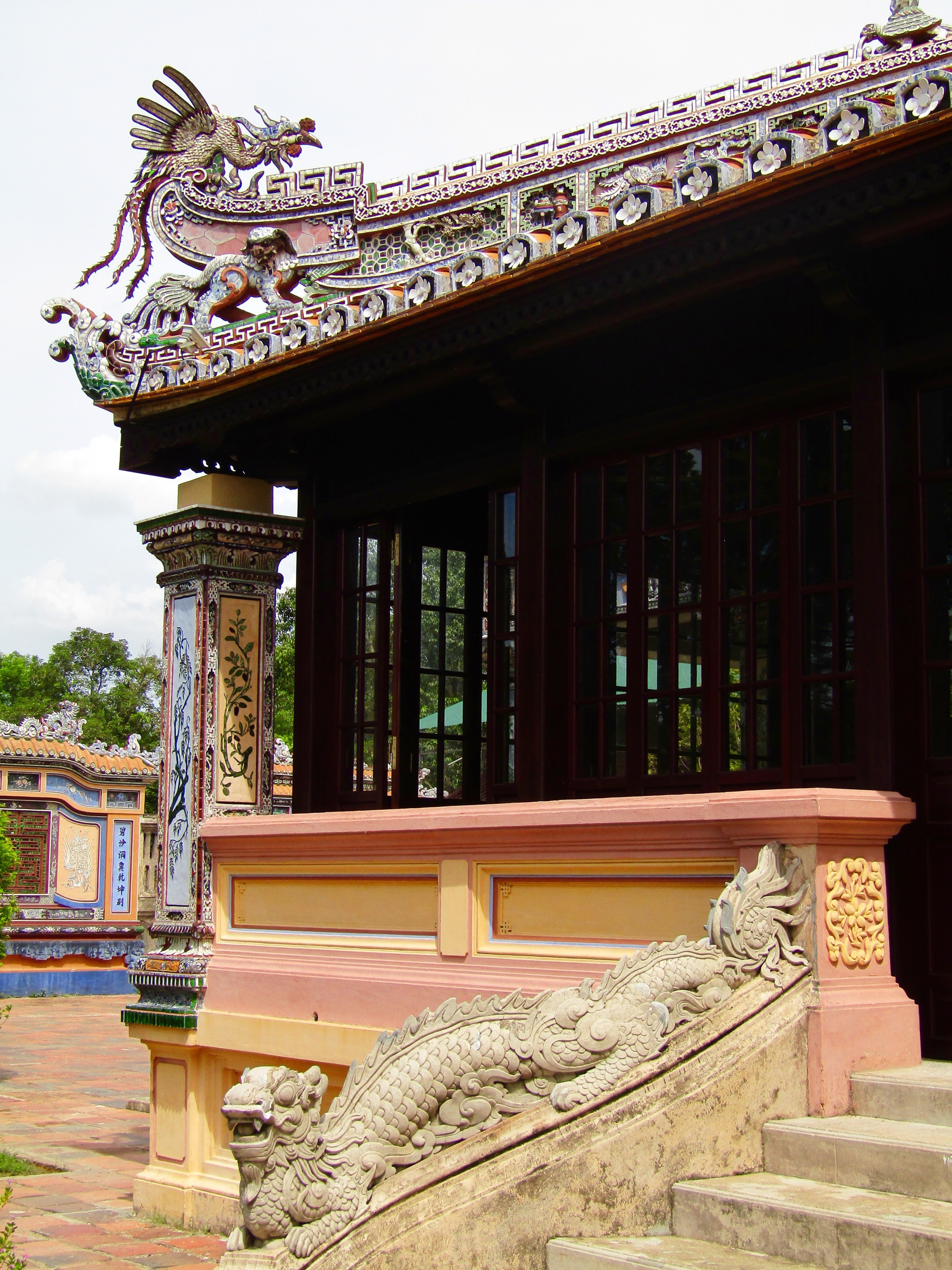 A building inside Hue's Imperial Palace. The palace was heavily damaged during the Tet Offensive in the Vietnam War. Of the 160 buildings in the complex, only 10 survived the battle. The remaining buildings were added to the UNESCO World Heritage List in 1993 and restoration work continues to this day.