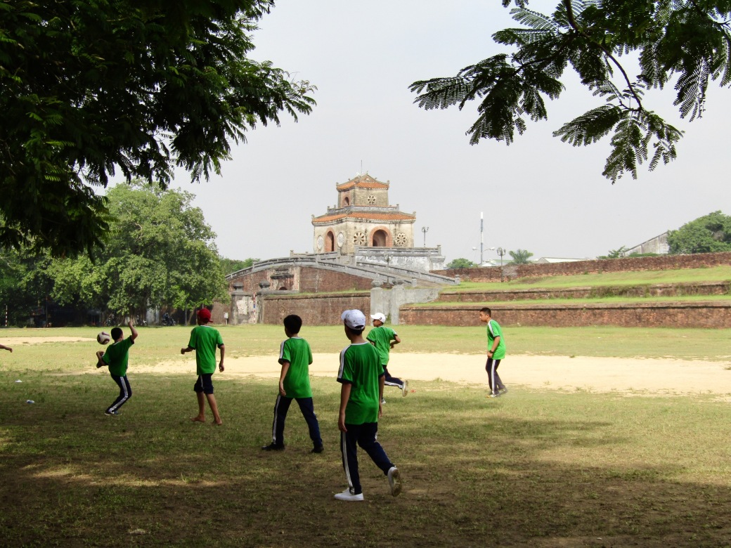 While I snapped pictures outside the military museum, Viktoria was making friends with some kids playing soccer in the shadow of Thuong Tu gate, one of the entrances to the outer grounds of the Imperial Palace known as the Citadel. One boy acted as the group's spokesman, telling us they were 14 years old and in the eighth grade at a school down the road.