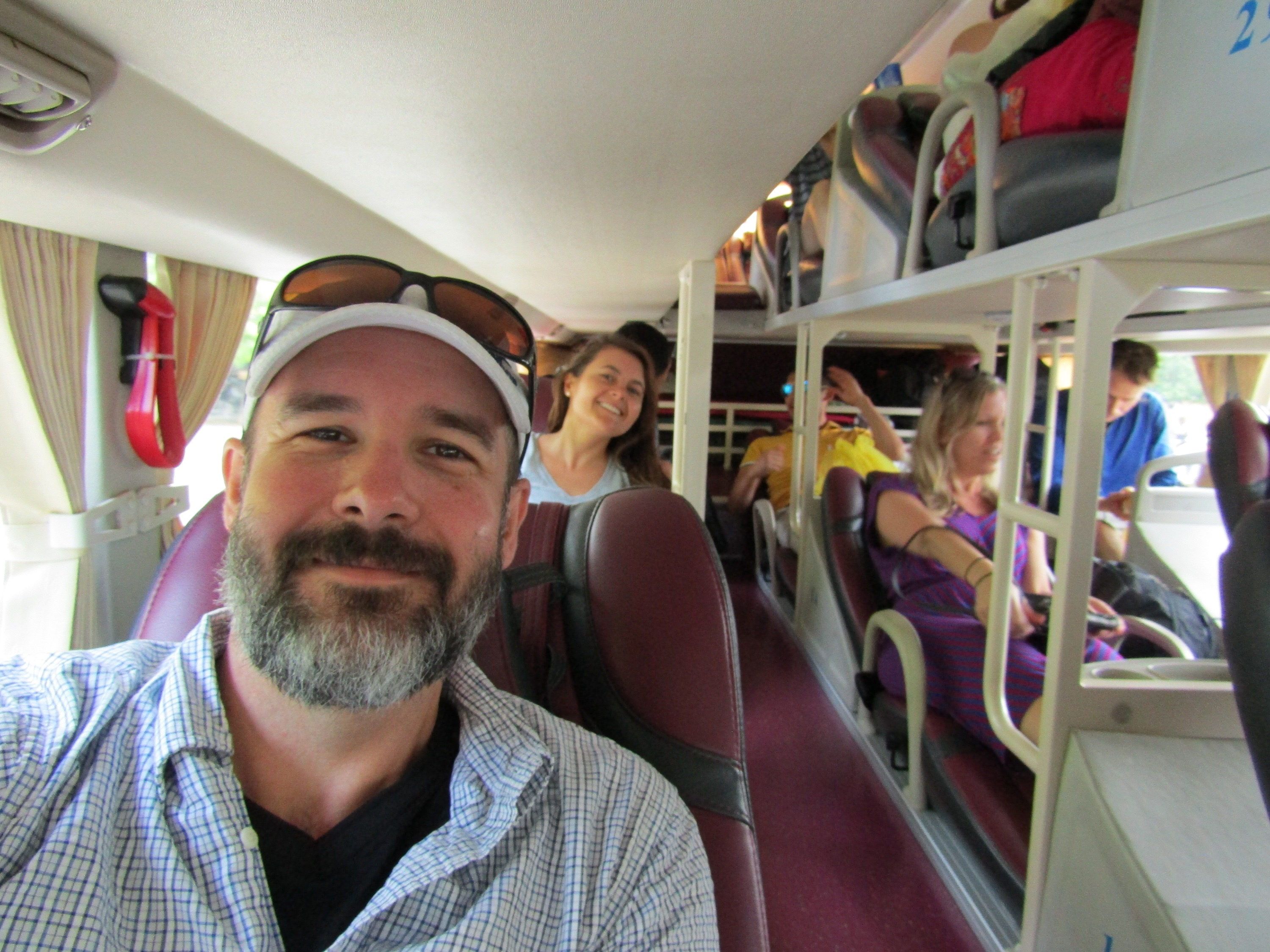 We knew our tour group would be making the trip from Hue to Hoi An on a public bus, but we were all surprised when a luxury coach showed up. Complete with reclining lounge seats and a complimentary bottle of water, it was a far cry from the #17 city bus from the airport in Hanoi. Sure enough, we picked up and dropped off passengers all the along the four-plus hour route.