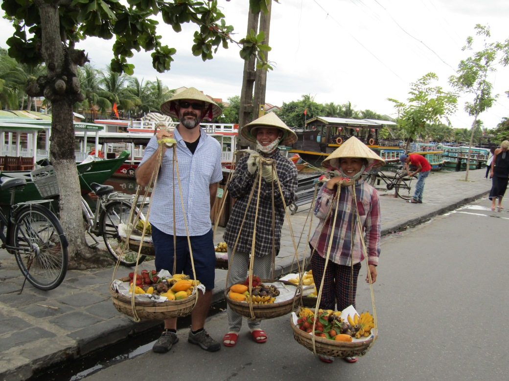 The noi la (conical hats) and carrying poles are still everyday tools for street vendors in Vietnam. Three ladies in Hoi An's old town were selling fruit and thought I needed to try the gear on for size. I overpaid for some mangos and lychee afterward, figuring the extra amount was for the fun memory.