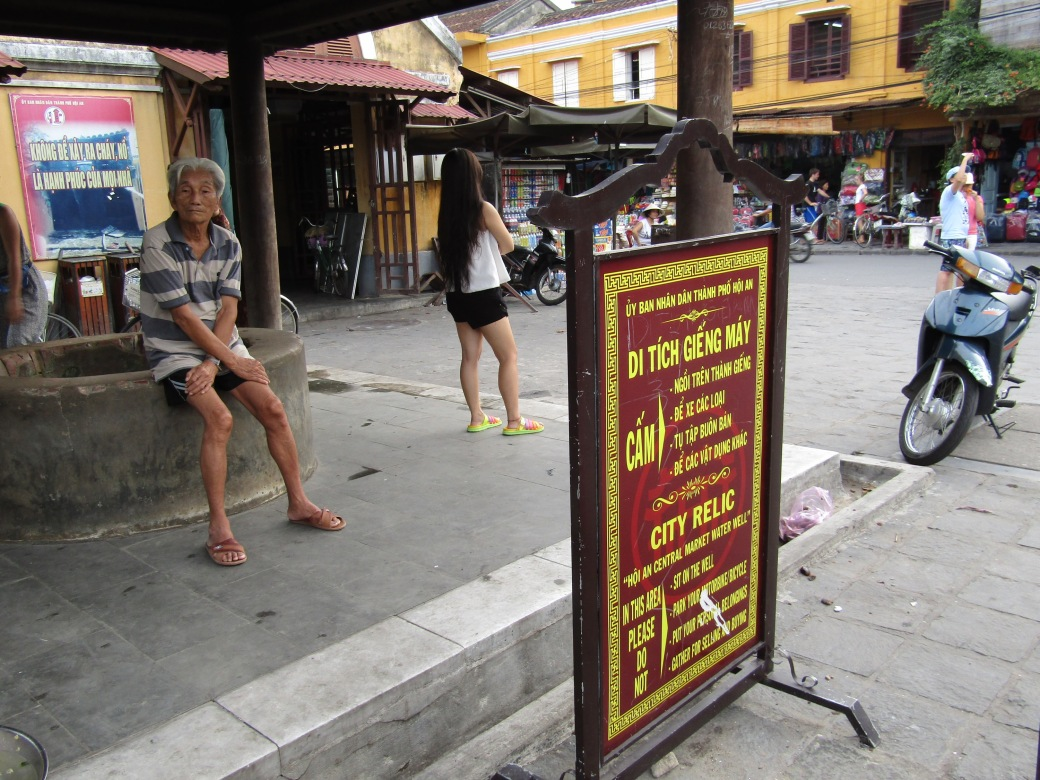 The Hoi An Market Water Well is among the many tourist sights in the city, but we were more amused by the blatant disregard for the posted rules sign which clearly states both