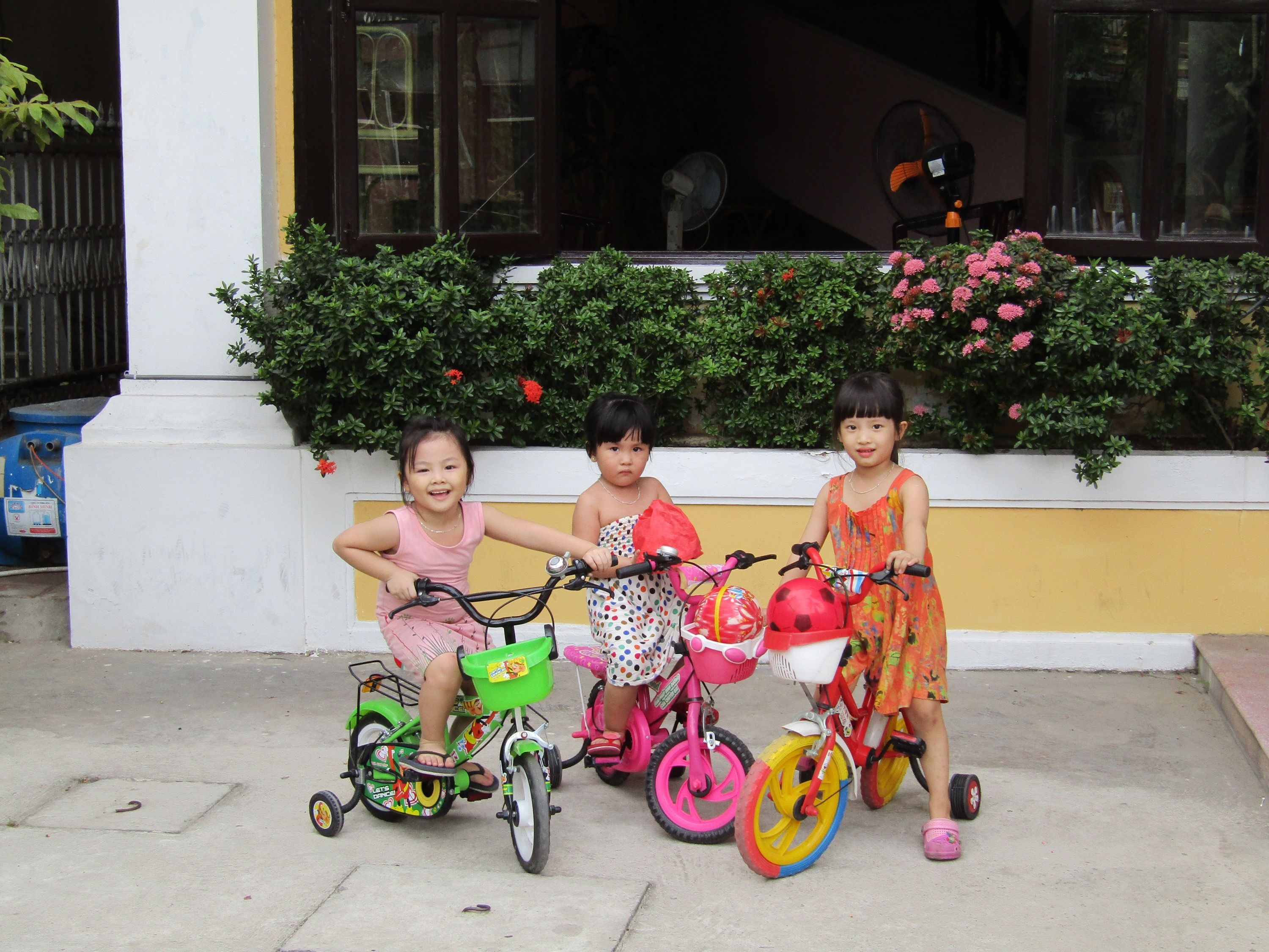 When we returned from exploring the old town area, these three little girls were riding their bikes in the parking area of our hotel. When we asked to photograph them, the girl on the left jumped into action. Clearly the ringleader, she got them all into position for the photo. The girl on the right followed along, but the girl in the middle didn't quite trust us...