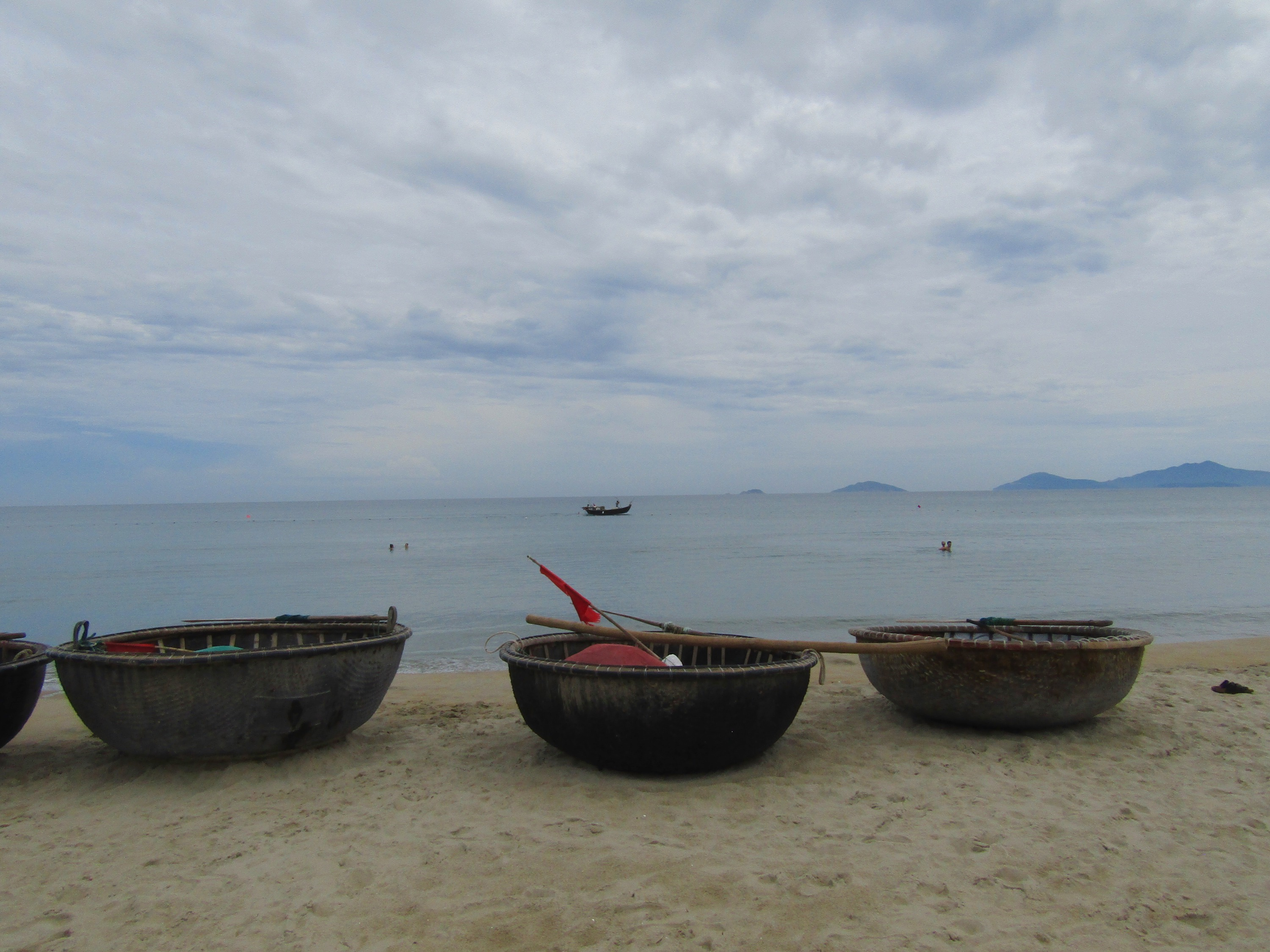 Several bamboo bowl boats were lined up on the beach. Local craftsmen have been making the boats for centuries, using a mixture of tree resin and rice bran to waterproof the vessels. They seem impossible to manuever, but the bowl captains have mastered it!