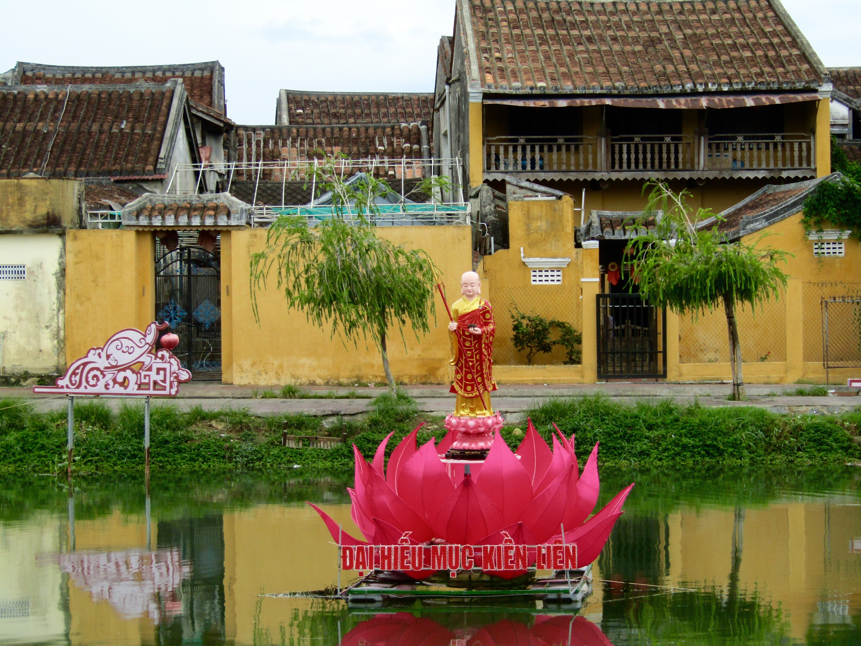 Ornate decorations floated all along the Thu Bon River, including this one depicting Maudgalyāyana, a disciple of Buddha, emerging from a lotus flower.