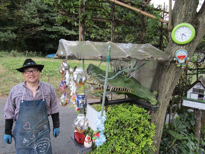 Kotiya-san, an artist with an eccentric style, came out to greet us along the path. He gave us one of his pinwheels made from old water bottles.