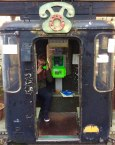An old cable car has been turned into a public phone booth in Nikko's city center
