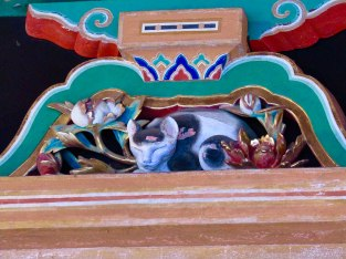 The Sleeping Cat (Nemuri-neko) of Tōshō-gū Shrine rests above the gate leading to the tomb of Tokugawa Ieyasu