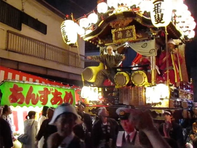 One of the large floats (or dashi) makes its way through a narrow side street in central Kawagoe