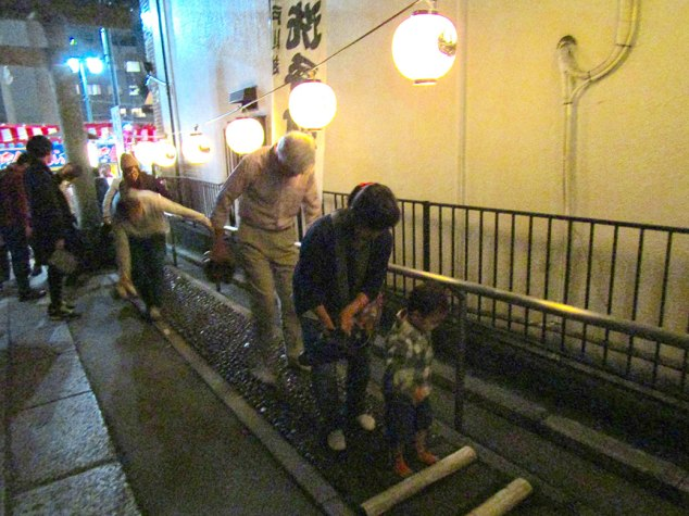 The family takes a trip down the reflexology foot path leading into Kumano Shrine