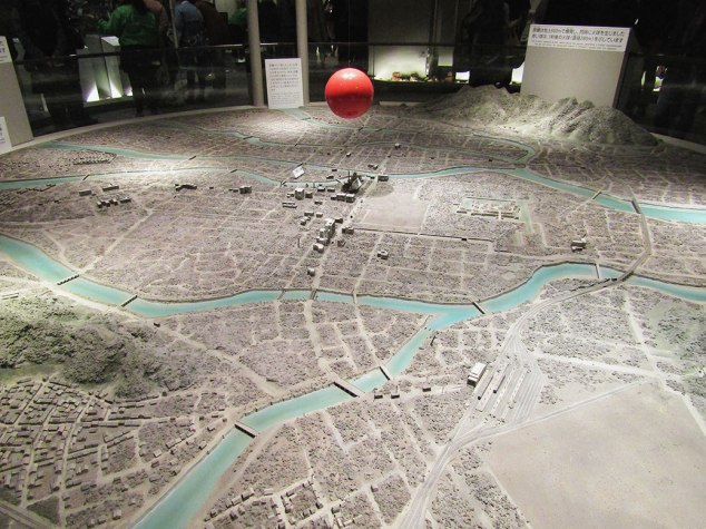 A scale model of Hiroshima showing the size of the fireball created by the atomic bomb and complete destruction of the surrounding area.