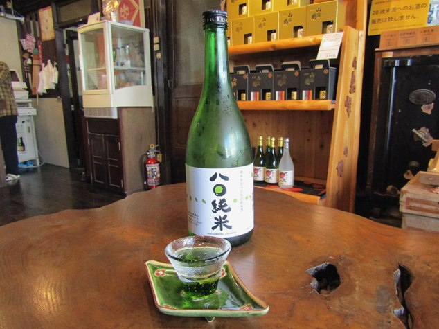 "A sample of the Sanyotsuru Hachimaru Junmai, a typical table sake. We bought a couple of the ""Fuji"" glass that the samples were served in."