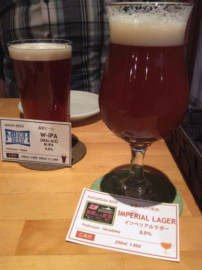 An Imperial Lager from Hiroshima's Kure Beer (Kaigun San) and a Double IPA from Osaka's Minoh Beer at RAKUBEER, a craft beer pub in central Hiroshima
