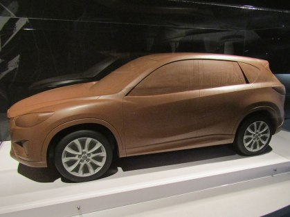 The small-scale clay version of the CX-series crossover SUV
