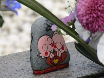 A small painted stone was tucked behind the flowers in front of the Memorial Cenotaph