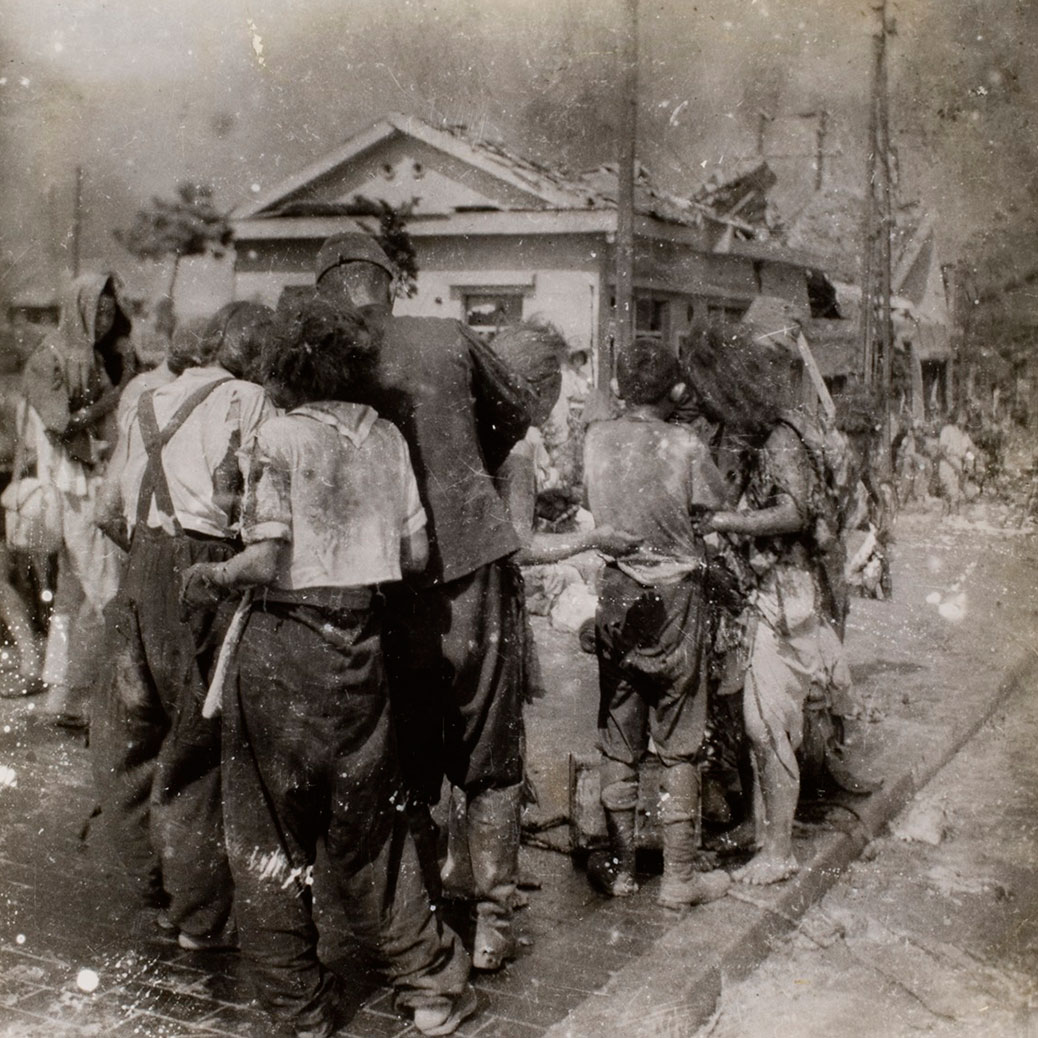Yoshito Matsushige's photo of a makeshift relief center, one of only a handful of known photos from the day of the bombing. The young girl at the back found her father at the relief station, but her mother was killed in the blast.